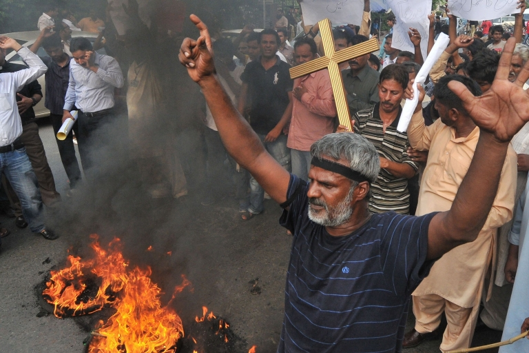 <p>Pakistani Christians stage a protest on Sept. 22, 2013, in Lahore against the killing of their community members in twin suicide bomb attacks on a historic church in Peshawar.</p>