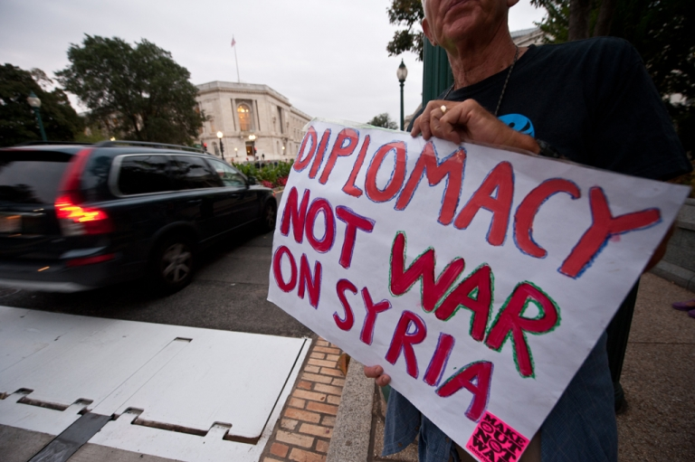 <p>People protest against a US military intervention in Syria in front of the Cannon House Office Building near the US Capitol as mebers of the US Congress leave an administration briefing on Syria to lawmakers in Washington on September 9, 2013.</p>