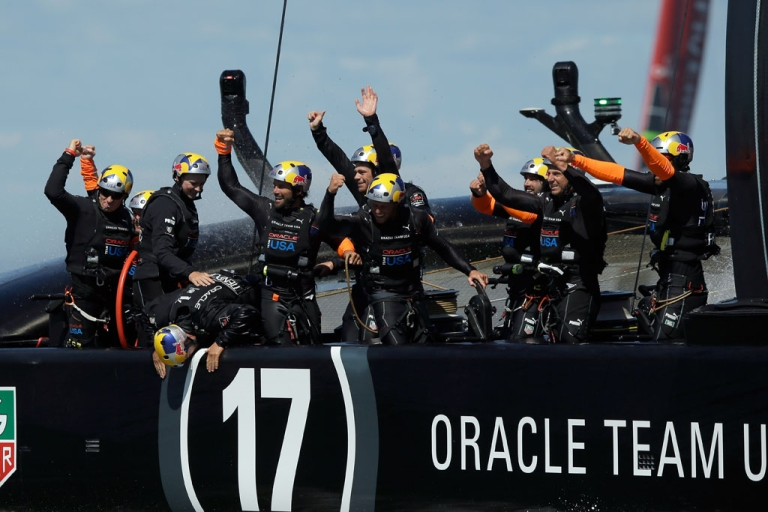 <p>Oracle Team USA crew members skippered by James Spithill celebrates after they beat Emirates Team New Zealand skippered by Dean Barker in race 19 to win the America's Cup on September 25, 2013 in San Francisco, California.</p>