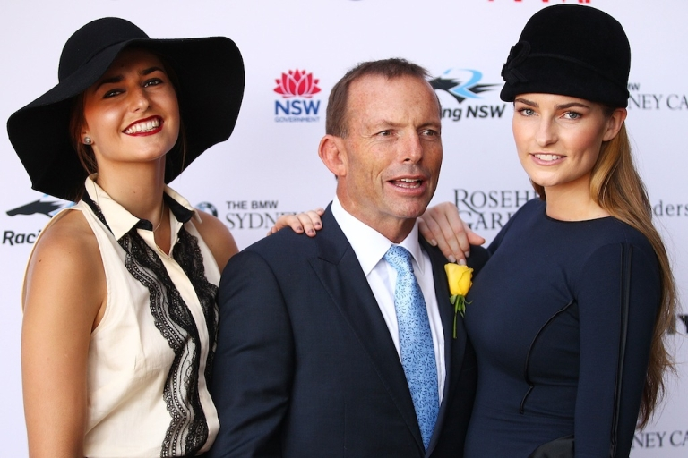 <p>Tony Abbott poses with his daughters Bridget and Frances at Rosehill Gardens on April 7, 2012 in Sydney, Australia. Abbott is the frontrunner to become Australia's next prime minister.</p>