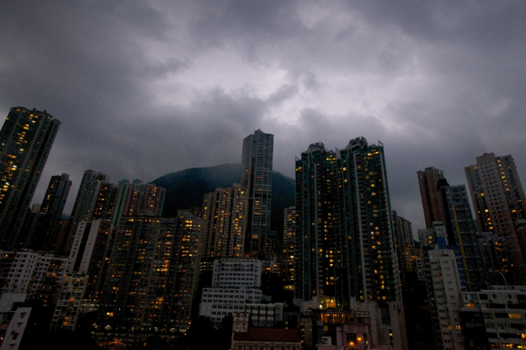 <p>Dark clouds are pictured over the skyline of Hong Kong island as Typhoon Usagi approaches the territory on September 22, 2013. Severe Typhoon Usagi barrelled towards Hong Kong on September 22, shutting down one of the world's busiest sea ports and throwing flight schedules into disarray from Europe to the United States.</p>