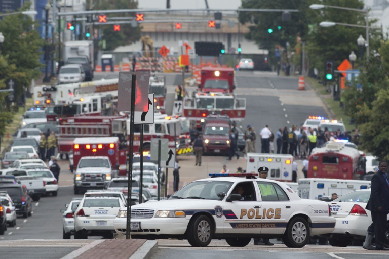 <p>Police and firefighters respond to the report of a shooting at the Navy Yard in Washington, D.C., September 16, 2013.</p>