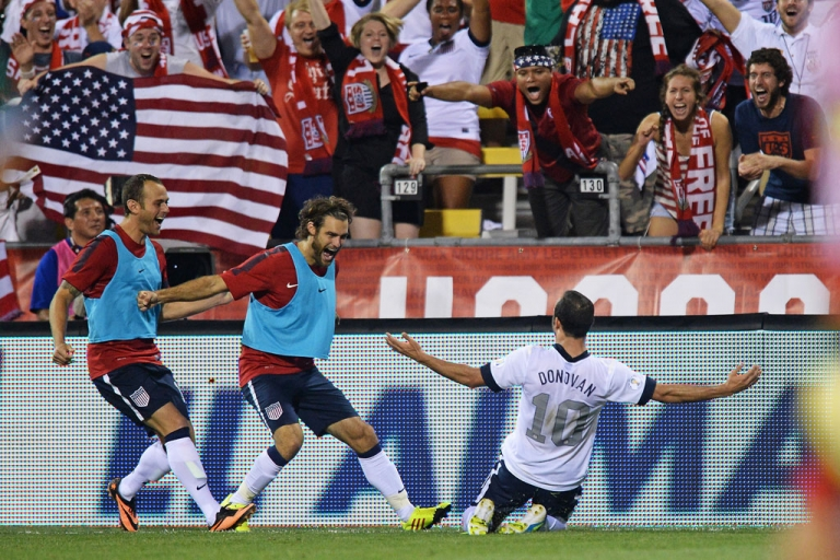 <p>Landon Donovan of the United States soccer team celebrates his second-half goal against Mexico with teammates Brad Davis, far left, and Graham Zusi on Sept. 10, 2013, in Columbus, Ohio. The United States defeated Mexico 2-0.</p>