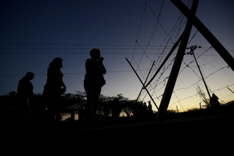 <p>Relatives of inmates await outside of the Uribana prison in Lara state, Venezuela, on January 26, 2013, a day after a riot broke out. Another riot broke out on September 16, 2013 at Venezuela's Sabaneta prison, leaving 16 dead.</p>