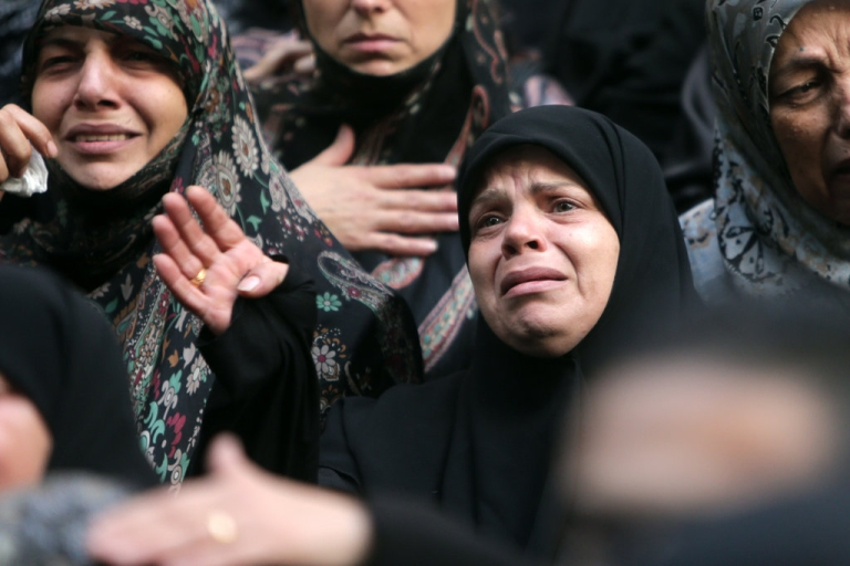<p>Shia women mourn during the funeral of four Iranian embassy security guards who were killed in the suicide attack outside the Iranian Embassy in Beirut. Thousands of people turned out to mourn for the guards, all of whom were members of Lebanon's powerful Shia movement Hezbollah, which is also backed by Iran and is fighting alongside Assad's troops against Sunni-led rebels.</p>