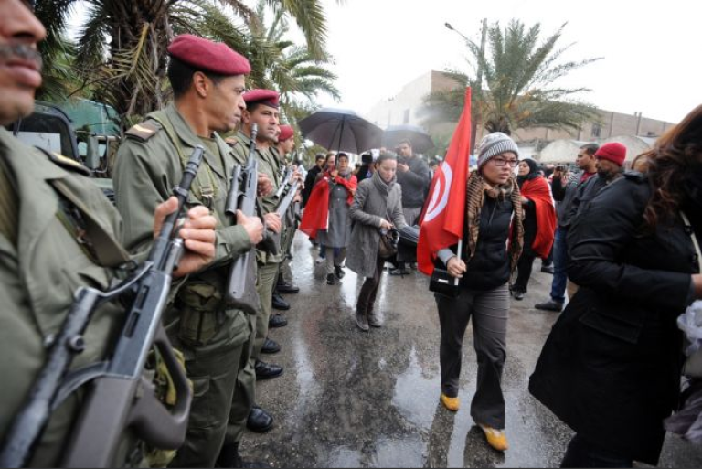 <p>Tunisian soldiers stand guard during Chokri Belaid's funeral procession through the capital, Feb. 8, 2013.</p>