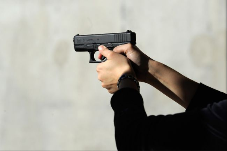 <p>Alexis Silva shoots her Glock 27 .40 caliber handgun at the Southwest Regional Park shooting range near the Crossroads of the West Gun Show at the Pima County Fairgrounds on January 15, 2011 in Tucson.</p>