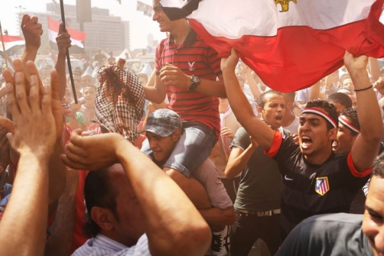 <p>People dance and cheer at Tahrir Square, the day after former Egyptian President Mohamed Morsi, the country's first democratically elected president, was ousted from power on July 4, 2013 in Cairo, Egypt. Adly Mansour, chief justice of the Supreme Constitutional Court, was sworn in as the interim head of state in ceremony in Cairo in the morning of July 4, the day after Morsi was placed under house arrest by the Egyptian military and the constitution was suspended.</p>