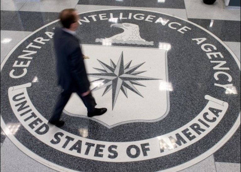 <p>A man crosses the Central Intelligence Agency (CIA) logo in the lobby of CIA Headquarters in Langley, Virginia.</p>