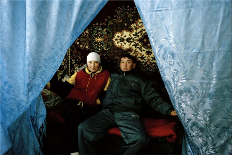 <p>Aizat and Murat three days after the kidnap and forced betrothal of Aizat in Issk-Kul Oblast. She resisted marriage to Murat, a stranger, for as long as possible but was persuaded to go through with it by Murat's grandmother who, at 82, commands much respect according to Kyrgyz lore. During a kidnap, elders are often summoned in order to influence the bride to stay.</p>