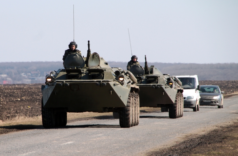 <p>A Ukrainian armored vehicle takes position near the border with Russia. Eyewitnesses filmed miles of Russian armored vehicles moving toward the border on April 24, 2013.</p>