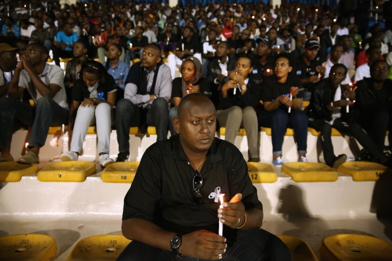<p>Rwandans hold a candle light vigil at Amahoro Stadium during the 20th anniversary commemoration of the 1994 genocide April 7, 2014 in Kigali, Rwanda. Thousands of Rwandans and global leaders, past and present, joined together to remember the country's 1994 genocide, when more than 800,000 ethnic Tutsi and moderate Hutus were slaughtered over a 100 day period.</p>