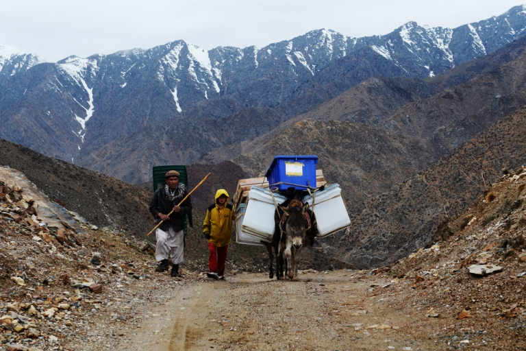 <p>Afghan villagers use donkeys to transport election material in the mountains of Shutul District in northern Afghanistan on April 4, 2014.</p>