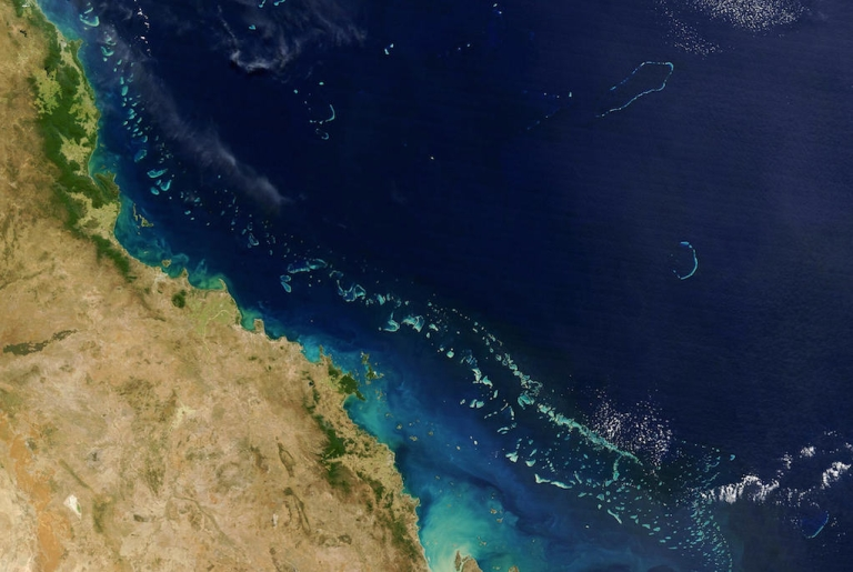 <p>Stretching along more than 1,200 miles along Australia's eastern coast the Great Barrier Reef, seen here from space, is one of the world's foremost natural wonders. Scientists object to new plans to dump and drill in its midst.</p>