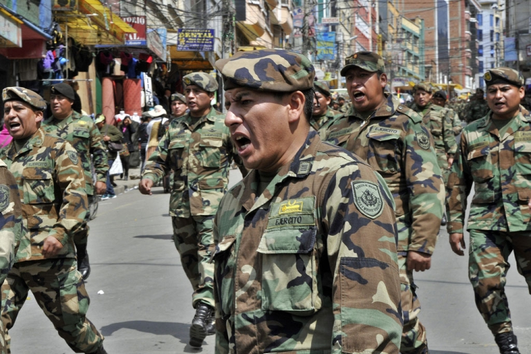 <p>Bolivian Army, Navy and Air Force non-commissioned officers in uniform marched along the streets of La Paz on April 24, 2014.</p>