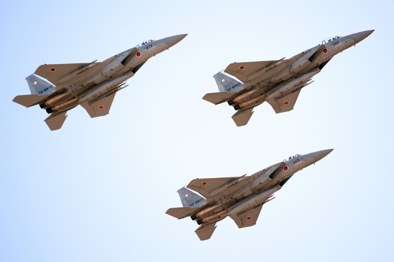 <p>F-15 jets fly during the military review at the Ground Self-Defence Force's Asaka training ground on October 27, 2013.</p>