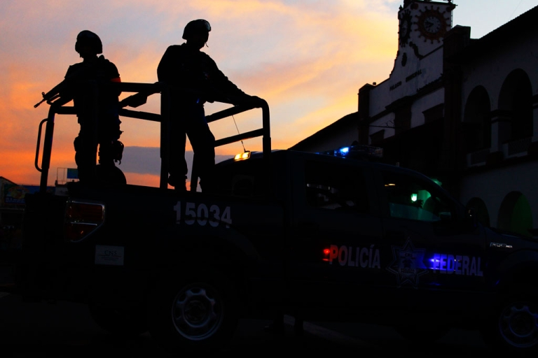 <p>Mexican federal police patrol during a march for peace in Apatzingan, Michoacan State, Mexico, on Jan. 18, 2014.</p>