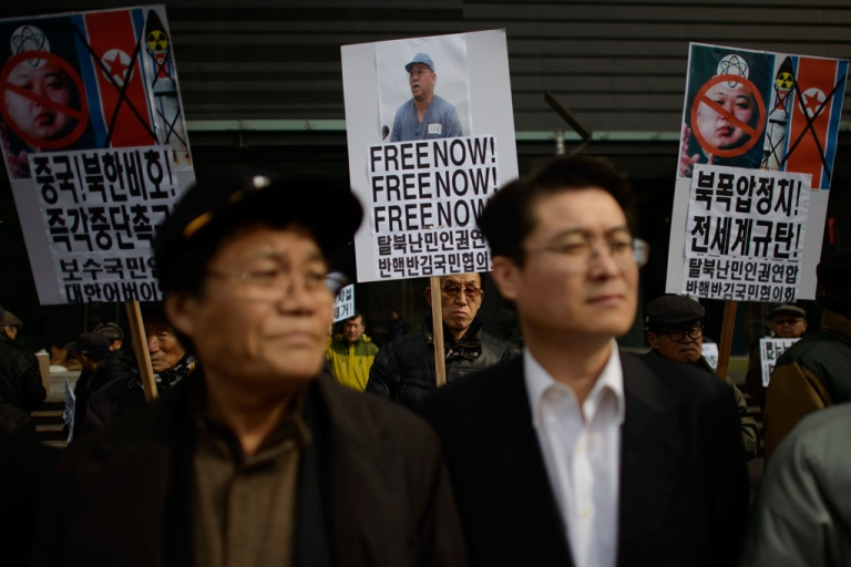 <p>A conservative anti-North Korean activist holds a placard calling for the release of detained US missionary Kenneth Bae during a protest against the North Korean regime, in Seoul on Feb. 16, 2014.</p>
