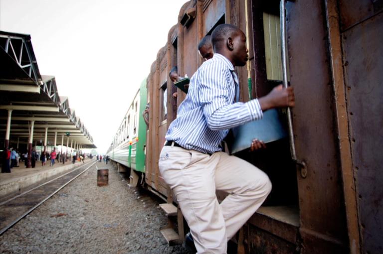 <p>A man boards the Nairobi-Mombasa train in Kenya.</p>