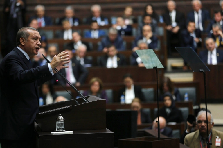 <p>Turkey's Prime Minister Recep Tayyip Erdogan gives a speech in front of Justice and Development party's members of parliament at the Turkish parliament on April 15, 2014.</p>