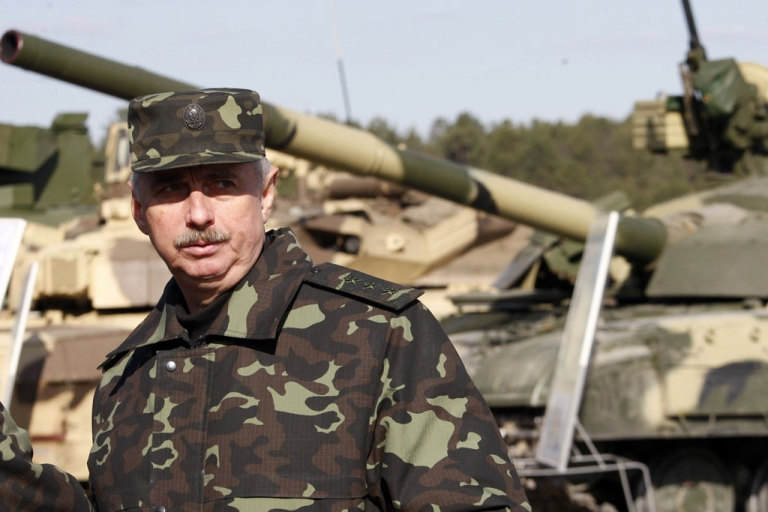 <p>Acting Minister of Defense of Ukraine Michail Koval attends military exercises on the firing range in Desna, Chernigiv region on April 2, 2014. Russia on Wednesday accused NATO of succumbing to 'Cold War' instincts after the alliance suspended all cooperation with Moscow over the Crimea crisis.</p>