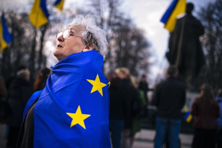 <p>Don't get your hopes up: A woman wrapped in an EU flag at a pro-Ukraine rally in the eastern city of Lugansk on Tuesday.</p>