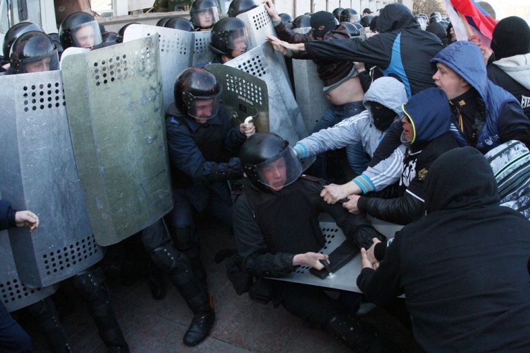 <p>Pro-Russian supporters clash with members of the riot police as they storm the regional administration building in the eastern Ukrainian city of Donetsk on April 6, 2014.</p>