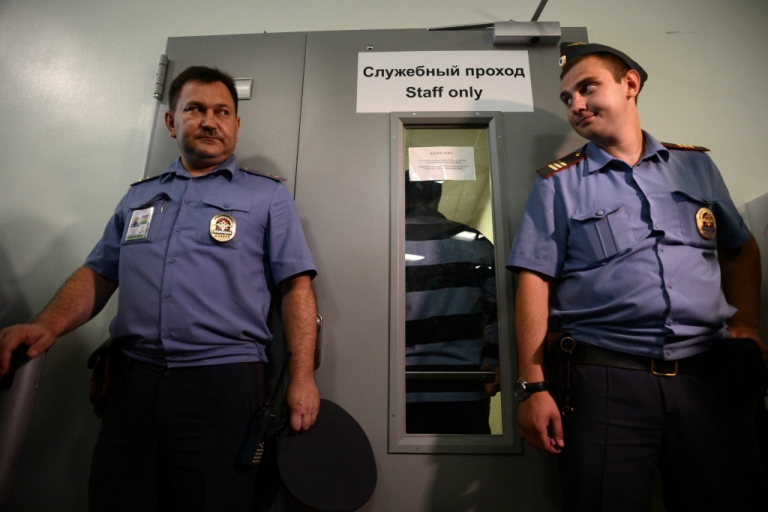 <p>Police officers guard the entrance to Terminal F of Moscow's Sheremetyevo airport, on July 12, 2013, during a meeting between Russian rights activists and lawyers for US National Security Agency fugitive leaker Edward Snowden.</p>