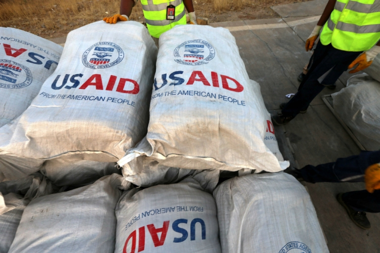 <p>Airport personnel check humanitarian supplies after 60 tons of aid from USAID were unloaded from a plane at the airport in Arbil, the capital of the autonomous Kurdish region of northern Iraq.</p>