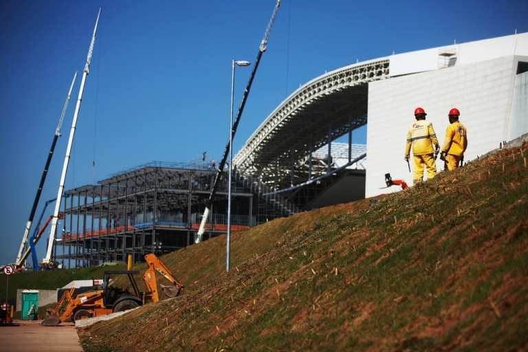 <p>Construction work continues on temporary seating at the Itaquerao stadium, also known as Arena de Sao Paulo and Arena Corinthians, on April 29, 2014 in Sao Paulo, Brazil. The stadium is scheduled to host the opening World Cup match on June 12 between Brazil and Croatia.</p>