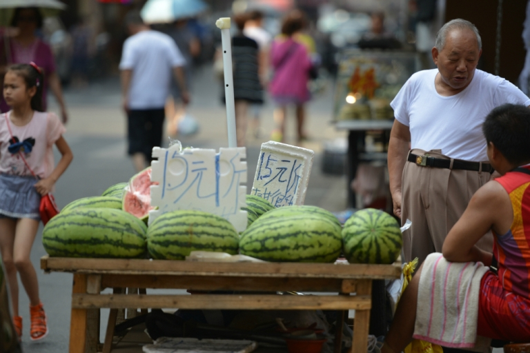 <p>Watermelons are displayed for sale in Shanghai on July 16, 2013.</p>