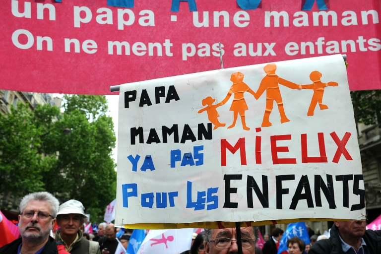 <p>PARIS, FRANCE - Anti-same sex marriage activists of the movement 'La Manif Pour Tous' protest during a demonstration on May 26, 2013.</p>