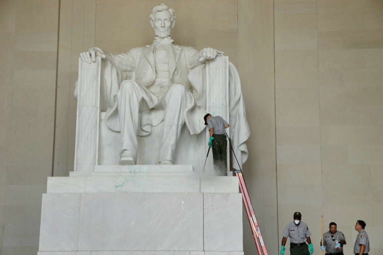 <p>U.S. National Park Service employees use a pressure washer to clean the Lincoln Memorial after it was vandalized with a splatter of green paint.</p>