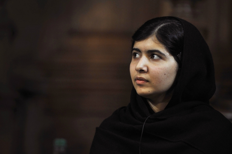<p>Malala Yousafzai, the Pakistani girl shot by the Taliban after campaigning for girls' education, attends the first Global Citizenship Commission at the University of Edinburgh in Scotland on October 19, 2013.</p>