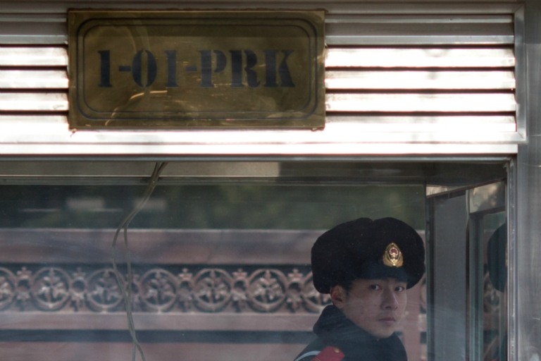 <p>A Chinese paramilitary guard stands on duty outside the North Korean embassy in Beijing on February 12, 2013.</p>