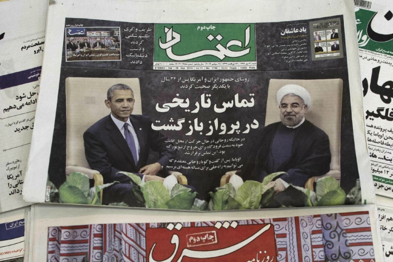 <p>A picture taken on September 28, 2013 in Tehran shows a Iranian newspaper with an image of Iranian President Hassan Rouhani and U.S. President Barack Obama.</p>