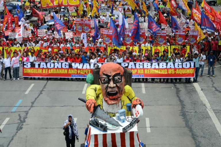 <p>Thousands of anti-government protestors march in the streets of Quezon City during Philippine President Benigno Aquino III's state of the nation address on July 22, 2013.</p>