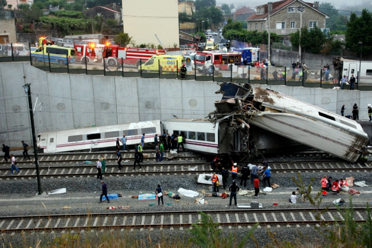 <p>Rescuers work at the site of a train derailment near the city of Santiago de Compostela where at least 35 people died and 200 people were injured.</p>