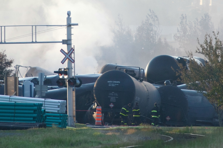 <p>Firefighters inspect the wreckage on July 7, 2013 of a freight train loaded with oil that derailed the day before in Lac-Megantic in Canada's Quebec province, sparking explosions that engulfed about 30 buildings in a wall of fire.</p>