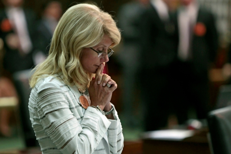 <p>State Sen. Wendy Davis (D-Ft. Worth) contemplates her 13-hour filibuster after the Democrats defeated the anti-abortion bill SB5, which was up for a vote on the last day of the legislative special session June 25, 2013 in Austin, Texas. A combination of Sen. Davis' filibuster and protests by reproductive rights advocates helped to ultimately defeat the controversial abortion legislation at midnight.</p>