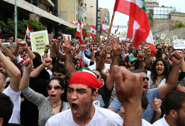 <p>Hundreds of people demonstrate against Lebanon's denominational system on March 6, 2011 in Beirut, calling for a secular state.</p>