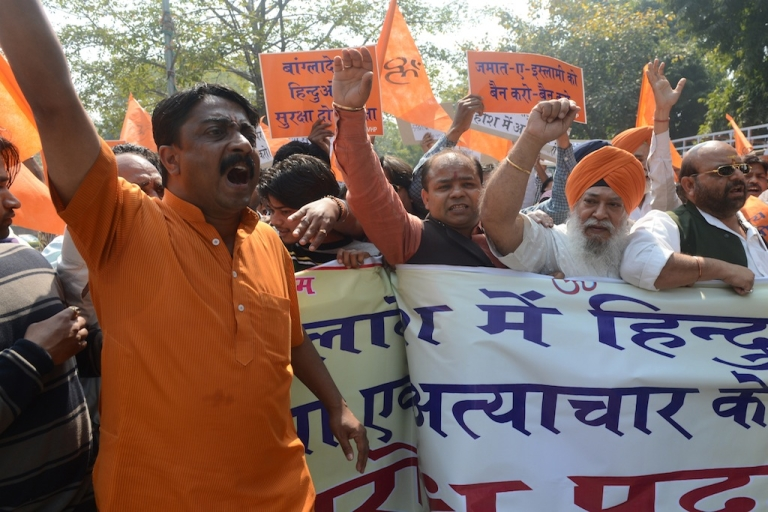 <p>Activists from The Bajrang Dal and Visva Hindu Parishad (VHP) shout anti-Bangladesh slogans in New Delhi on March 6, 2013, during a protest against recent attacks against minority Hindus in Bangladesh. Bangladesh?s main opposition leader Khaleda Zia has condemned recent attacks on Hindus in different parts of the country allegedly by activists of fundamentalist Jamaat-e-Islami, demandING punishment to perpetrators of the attacks.</p>