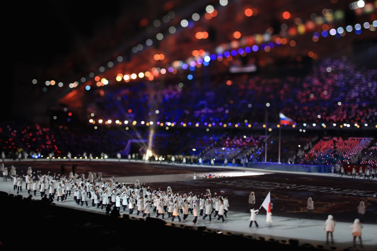<p>The Japanese team enter during the Opening Ceremony of the Sochi 2014 Winter Olympics</p>