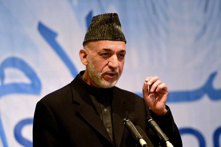 <p>Afghan President Hamid Karzai gestures as he attends the opening ceremony of a telecommunication private company in Kabul on February 4, 2014.</p>