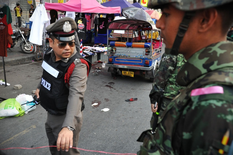 <p>Army soldiers and police stand guard at the scene of a deadly explosion at an anti-government rally on Feb. 23, 2014 in Bangkok, Thailand.</p>
