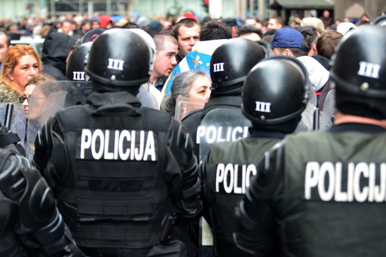 <p>Bosnian citizens' rights activists argue with riot police as they gather in front of Bosnia and Herzegovina's Presidency building in country's capital Sarajevo, on Feb. 9, 2014.</p>