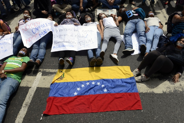 <p>Students lie on the ground in protest for the student killed during the demonstration on the eve against the government of Venezuelan President Nicolas Maduro, in Caracas on Feb. 13, 2014.</p>
