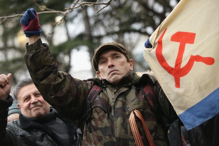 <p>Pro-Russian supporters rally outside the Crimean parliament on February 28, 2014 in Simferopol, Ukraine.</p>