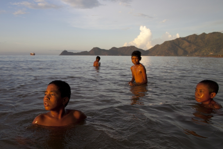 <p>East Timorese boys swim at a capitol city beach in April 2012.  Better known for its wars and poverty, this tiny nation has produced a Olympic skier, in one of history's more quixotic Olympic journeys.</p>