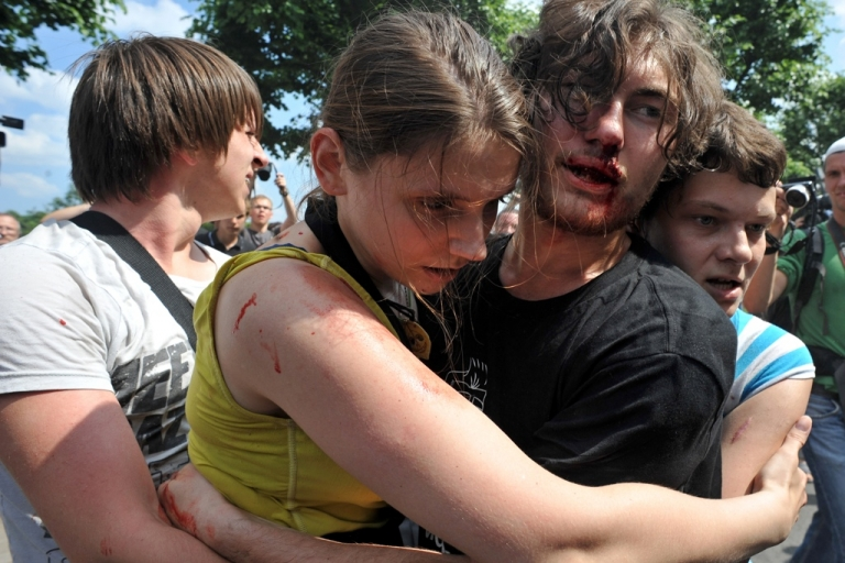 <p>Gay rights activists embrace each other after clashes with anti-gay demonstrators during a gay pride event in St. Petersburg on June 29, 2013. Russian police arrested dozens of people on Saturday after clashes erupted in the city of Saint Petersburg between pro- and anti-gay demonstrators.</p>